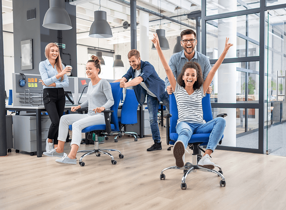 employees in office excited about how benefits can build a better workplace